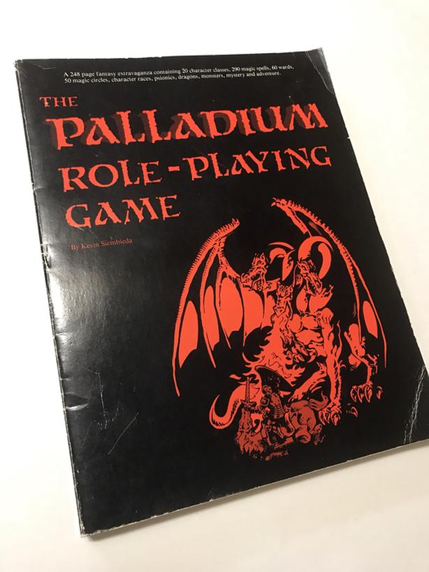 Palladium first edition softcover sourcebook with red cover art